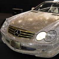 A customized Daimler AG Mercedes-Benz SL600 decorated with Swarovski crystals wows crowds at Tokyo Auto Salon in Chiba on Friday. | BLOOMBERG
