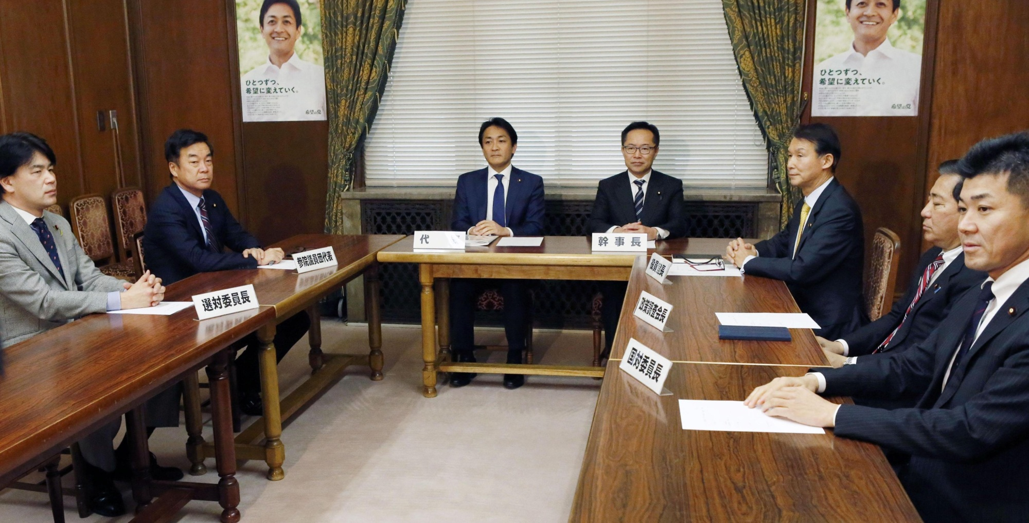 Shigefumi Matsuzawa (second from left), who heads Kibo no To (Party of Hope) in the Upper House, and Yuichiro Tamaki (third from left), leader of the party, gather at an emergency meeting of the party executive at the Diet on Wednesday. | KYODO