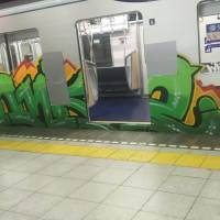 A Hibiya Line subway car is seen covered with graffiti on Monday morning in a picture provided by Twitter user @hatasan_oira. Operator Tokyo Metro Co. has been hit with three cases of vandalism over the past week.