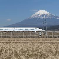 Japan's high-speed shinkansen date to the 1960s and have become a staple of domestic travel, with speeds of about 199 mph (320 kph), making for a 2.5 hour trip between Tokyo and Osaka — one of the most heavily trafficked routes. | GETTY IMAGES