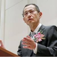 Shinya Yamanaka, who heads Kyoto University's iPS institute, delivers a speech in Kyoto on Wednesday. | KYODO