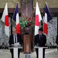 French Defense Minister Florence Parly (left), Foreign Minister Jean-Yves Le Drian (second from left), Japanese Foreign Minister Taro Kono and Defense Minister Itsunori Onodera attend a news conference in Tokyo Friday after their 'two plus two' foreign policy and security talks. | REUTERS