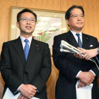 Motohisa Furukawa (left), secretary-general of Kibo no To (Party of Hope), and Teruhiko Mashiko, secretary-general of the Democratic Party, speak to reporters Monday in Tokyo after reaching a broad agreement to form a joint parliamentary group. | KYODO