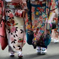 Women wear kimonos during their Coming-of-Age Day celebration ceremony in Tokyo on Jan. 8. | REUTERS