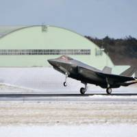 A next-generation F-35A stealth jet arrives at Misawa Air Base in Aomori Prefecture on Friday. | KYODO
