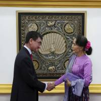 Myanmar's State Counselor and Foreign Minister Aung San Suu Kyi shakes hands with Foreign Minister Taro Kono after their joint press conference at the Ministry of Foreign Affairs in Naypyitaw, Myanmar, on Jan. 12. | AP