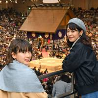 Female sumo fans, nicknamed sujo, which is short for sumo joshi (sumo girls), watch the bouts on the sixth day of the Kyushu Basho on Nov. 17, 2017. | KYODO