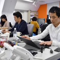 Peng Jenhui, who is from Taiwan, works as a business development manager at a Tokyo employment agency. He says Japan needs to foster an environment where foreign workers can live more easily without Japanese-language skills. | YOSHIAKI MIURA