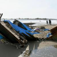 Seven bodies were found in this capsized wooden boat that washed ashore in Kanazawa, Ishikawa Prefecture, the police said Tuesday. | KYODO