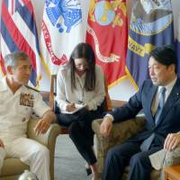 Defense Minister Itsunori Onodera (right) on Tuesday asked U.S. Pacific Command chief Adm. Harry Harris to take measures to prevent accidents involving U.S. military aircraft in Okinawa. The two met at Camp H.M. Smith in Hawaii. | KYODO