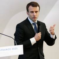 Then French Economy Minister Emmanuel Macron speaks during the 2015 presentation of the economic project within France's bid to host the 2025 World Expo, at the Louis Vuitton Arts Foundation in Paris. France on Sunday withdrew its bid for holding the World Expo 2025, citing financial reasons. | AFP-JIJI