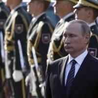 Russian President Vladimir Putin is seen attending a ceremony in Slovenia in 2016. Japan is reportedly considering inviting him around May next year in the hope of making progress in resolving a decades-long territorial row. | AP
