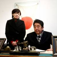 Prime Minister Shinzo Abe and his wife, Akie, visit the former home of Chiune Sugihara, a Japanese diplomat who worked to save thousands of Jews fleeing Nazi persecution during World War II, in Kaunas, Lithuania, on Sunday. | REUTERS