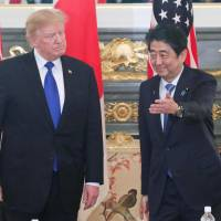 U.S. President Donald Trump and Prime Minister Shinzo Abe stand in the state guesthouse in Tokyo's Akasaka district in November during Trump's visit to the capital.   POOL / VIA KYODO