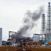 A photo provided by Tokyo Electric Power Company Holdings Inc. shows smoke coming from reactor building 3 at the Fukushima No. 1 nuclear plant on March 21, 2011. | KYODO
