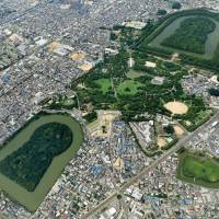 Ancient tumulus clusters are shown in Osaka Prefecture, including the expansive burial mound of Emperor Nintoku known as Daisen Kofun (top right). | KYODO