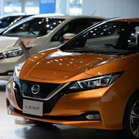 Nissan Motor Co. Leaf electric vehicles are displayed at the company's showroom in Yokohama in November 2017. | BLOOMBERG
