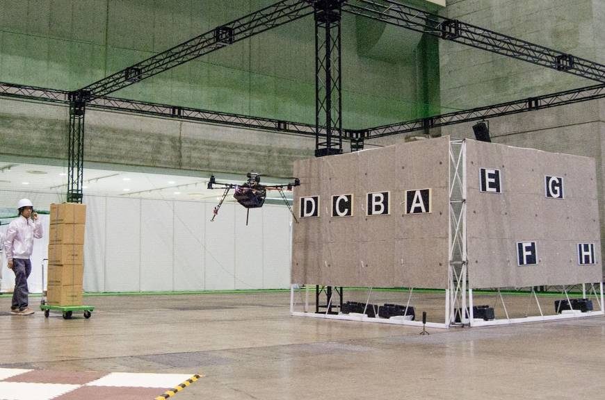 A drone fitted with stereo fisheye lens navigates the inside of a building during tests.