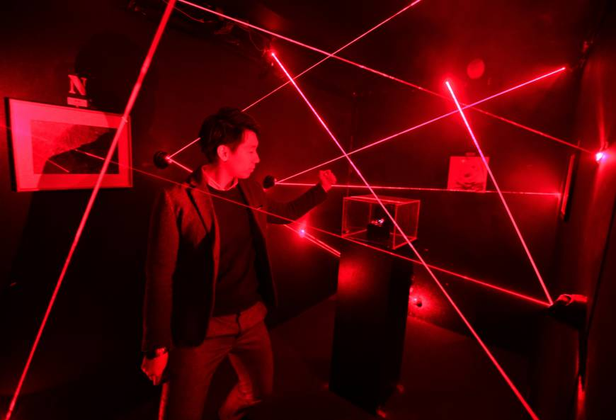 K&K Entertainment founder William Ding demonstrates how to avoid lasers at Super Escape Laser Trap.