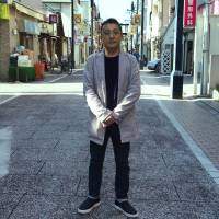 Tetsuro Kamei, owner of Gallery Kamei, recalls being raised by the community in Tokyo's Togoshi Ginza.   MASAMI ITO