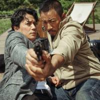 Firing blanks: Masaharu Fukuyama and Zhang Hanyu in 'Manhunt.' | © 2017 MEDIA ASIA FILM PRODUCTION LIMITED ALL RIGHTS RESERVED.