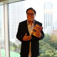 Financial freedom: Robert Kiyosaki tries to encourage workers to break free from the grueling 12-plus-hour shifts that salarymen are used to. | KYODO