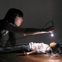 Bright lights: Artist Naoko Tanaka performs in an installation titled 'The shine thrower' in Berlin, January 2011. | COURTESTY OF NAOKO TANAKA