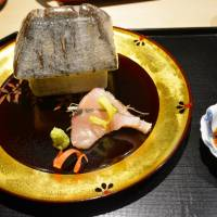 New Year's treat: Fugu served in a 'Lilliputian house' on a plate rimmed with gold. | J. J. O'DONOGHUE