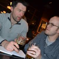 Winning pair: Rob Bright (left) and Joe Robson, creators of the BeerTengoku website, sample some craft beer at a Yokohama  bar in December. | DANIEL TRAYLOR