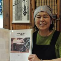 Before and after: Ryukyusabo Suru's Hisako Okuma shows       a picture of her restaurant shortly before opening in 2004. davey young | DAVEY YOUNG