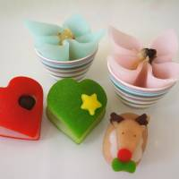 Colorful 'nikiniki' miniatures made from 'yatsuhashi,' Kyoto's local confectionary, showcased at an outlet in downtown Kyoto on Dec. 19, 2017. Kanako Suzuka, heir of a famous yatsuhashi store, says while her brand seems to be a totally new approach in the classic sweet's some 330-year history, the basics have remained exactly the same. | KYODO