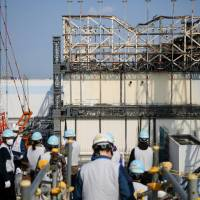 Energy crisis: Reporters are taken on a tour of the Fukushima No. 1 nuclear power plant on April 14, 2017, as workers begin its decommissioning process. Though the power plant's meltdown raised awareness of nuclear power issues, some believe nuclear power still has a future in Japan. | KYODO