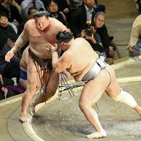 Was he pushed?: Yokozuna Hakuho (left) loses to Hokutofuji at the New Year Grand Sumo Tournament in Tokyo on Tuesday. | KYODO