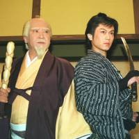 Good is rewarded, evil punished: Kotaro Satomi (left) and Kiyoshi Hikawa pose at a promotional event in 2003 for 'Mito Kōmon,' Japan's longest-running jidaigeki, which was broadcast  on TBS from 1969 to 2011. | KYODO