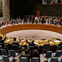 U.N. Security Council members vote on an Egyptian-drafted resolution calling on the U.S. to withdraw its recognition of Jerusalem as Israel's capital, a rare instance where Japan took a clear position on the world stage. | REUTERS
