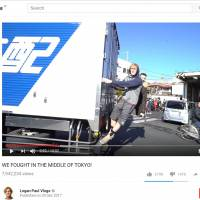 No ticket to ride: Logan Paul gets an unauthorized lift from a delivery truck in Tokyo in a clip from one of his YouTube videos.