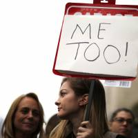 People participate in a 'MeToo' protest march for survivors of sexual harassment and their supporters in the Hollywood area in Los Angeles on Nov. 12. | REUTERS
