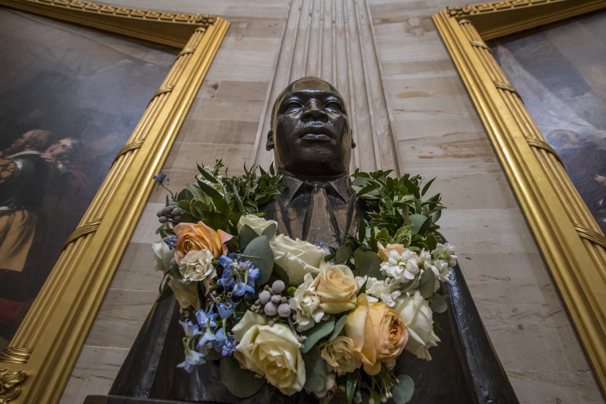 Towering figure: A statue of Martin Luther King Jr. in the U.S. Capitol Rotunda in Washington is adorned with flowers ahead of his birthday on Jan. 15. | AP