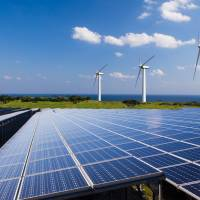 Renewable energy sources such as solar and wind power have near-zero marginal cost. | GETTY IMAGES