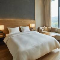 Minimalist stay: The new Muji Hotel, which opened in Shenzhen, China, on Jan. 18 houses 79 guest rooms, a restaurant, library and three meeting rooms. | PROVIDED BY RYOHIN KEIKAKU
