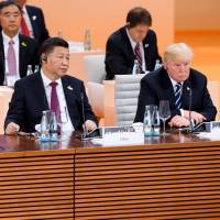 Chinese and U.S. Presidents Xi Jinping and Donald Trump, shown at the Group of 20 summit in July in Germany, both have designs on Europe and not all of their plans are friendly. | AP