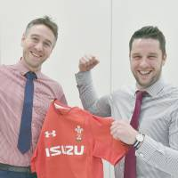 Welsh Rugby Union head of rugby participation Ryan Jones (left) and head of group sales and marketing Craig Maxwell pose for a photo in Tokyo this week. | YOSHIAKI MIURA