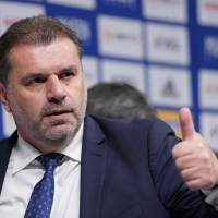 Ange Postecoglou gestures after being introduced as the new manager of Yokohama F. Marinos on Sunday. | AP