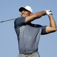 Tiger makes cut with birdie on 18th hole