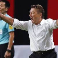 Former Urawa Reds manager Mihailo Petrovic, seen leading the team  against Consadole Sapporo in July, is the new Sapporo boss. | KYODO
