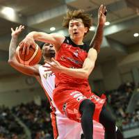Jets guard Fumio Nishimura passes the ball in the fourth quarter against the B-Corsairs on Saturday at Chiba Port Arena. Nishimura had a game-high eight assists in Chiba's 95-79 win over Yokohama. | B. LEAGUE