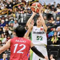 Jx-Eneos forward Yuki Miyazawa attempts a 3-point shot during Sunday's women's final of the 84th All-Japan Championship at Saitama Super Arena. The Sunflowers captured their fifth straight Empress' Cup. | KAZ NAGATSUKA