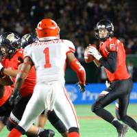 Fujitsu quarterback Colby Cameron looks for a receiver during the Rice Bowl against Nihon University on Wednesday at Tokyo Dome. Fujitsu won 37-9. | KUNIHITO GOTO