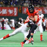 Frontiers receiver Teruaki Clark Nakamura had eight catches for 182 yards and a score against Nihon University, his alma mater, in the Rice Bowl on Wednesday. | KUNIHITO GOTO