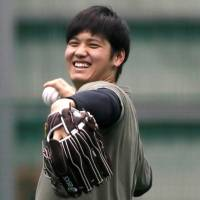 The Angels' Shohei Ohtani works out at the Hokkaido Nippon Ham Fighters' ni-gun facility in Kamagaya, Chiba Prefecture, on Friday. | REUTERS